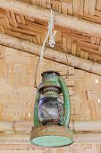 Antique pressure lamp in bamboo cottage