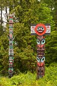 picture of indian totem pole  - Pair of totem poles in Stanley Park Vancouver British Columbia - JPG