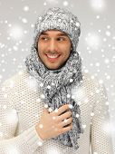 picture of handsome man in warm sweater, hat and scarf.