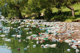 picture of plastic bottle  - heavy plastic pollution in wild beautiful landscape