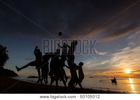 SUMATERA - AUGUST 23: Kids play soccer on the beach during sunset on August 23, 2013 in Padang, West Sumatera, Indonesia. Soccer is the most popular sports in South East Asia and the world.