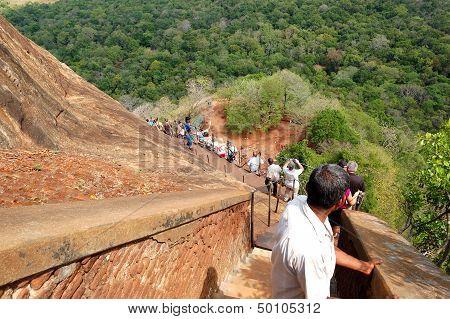 Sigiriya - October 15: The Tourist Walking Down  From Sigiriya (lion's Rock) Is An Ancient Rock Fort