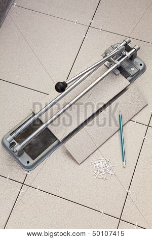 Tiles Cutting Works With Tile-cutter On Floor