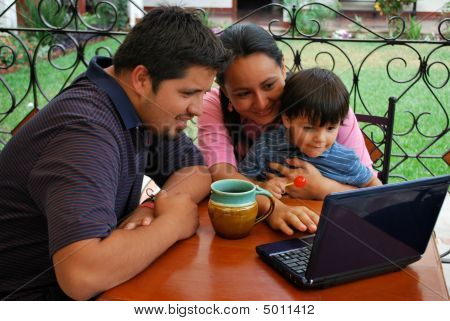 Family Using A Computer Together
