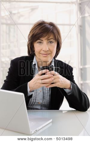 Senior Businesswomen With Coffee