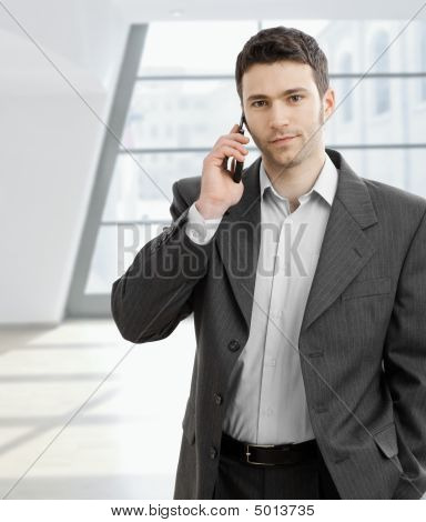 Businessman Taling On Mobile Phone