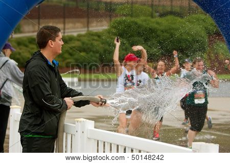Female Runners Get Soaked By Fire Hose At Finish Line
