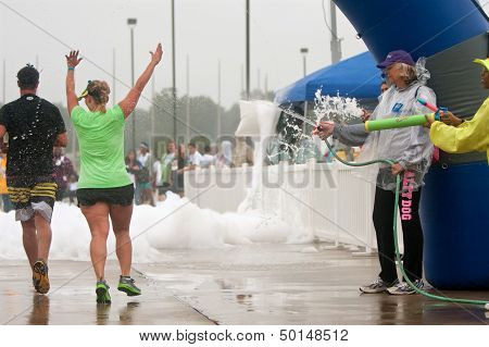 Runners Get Soaked By Squirt Guns At Race Finish Line