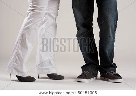 Two pairs of legs. Man's and woman's legs