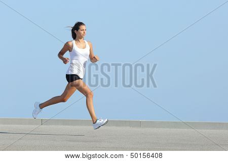 Beautiful Sportswoman Running With The Sky In The Background