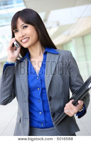 Asian Business Woman On The Phone