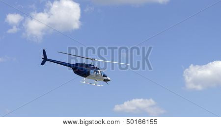 helicopter over blue sky