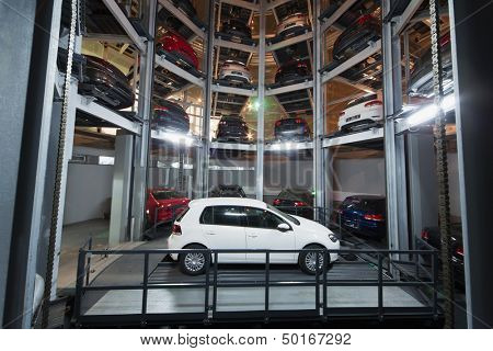 MOSCOW - JAN 11: The Volkswagen Golf on parking lot with a multi-story automated car parking system in Volkswagen Center Varshavka at night on January 11, 2013, Moscow, Russia