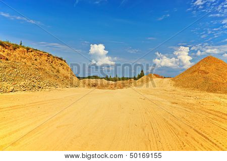 Sandy Road Between Hills In Sunny Summer Day