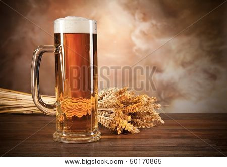 Glass of beer on woden table