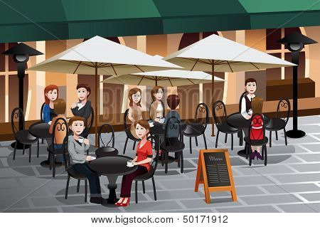People Enjoying Coffee Outside Of A Cafe