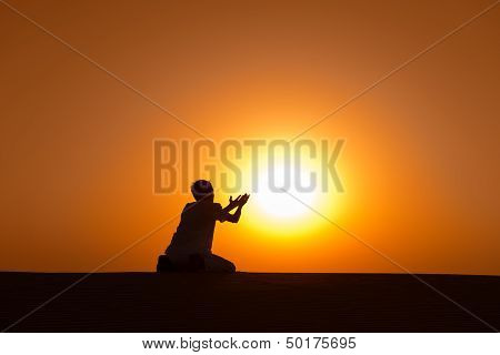 Man Silhouette Kneel And Pray For Help