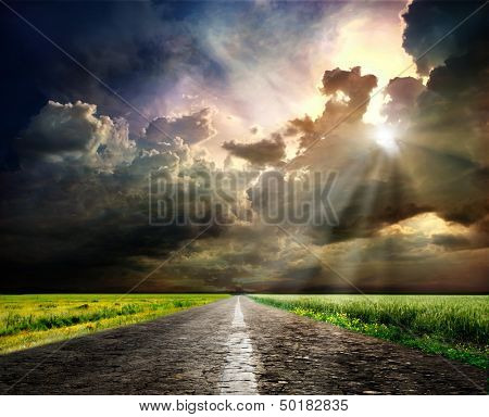 Sunset over blurred asphalt road