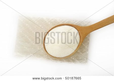 Gelatin Granules And Gelatin Sheet  On White