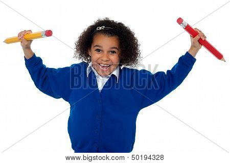 Fun Loving Elementary Girl Dancing With Pencils In Both Her Hands