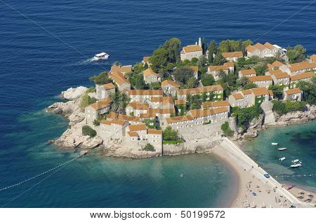 high view of fortified village on the islet Sveti Stefan, Montenegro