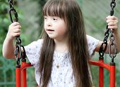 pic of playgroup  - Portrait of beautiful young girl on the playground - JPG
