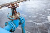 stock photo of sewage  - Blue valve gate for oxygen blowing in sewage water - JPG