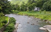 stock photo of woodstock  - This Vermont river the Ottauquechee flows right through the middle of the small town of Woodstock - JPG