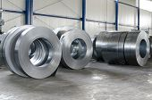 image of ironworker  - sheet tin metal rolls in production hall - JPG