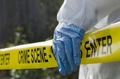stock photo of safety barrier  - Forensic investigator working at a crime scene - JPG