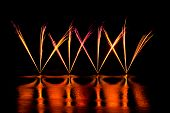 pic of guy fawks  - Streaks of Pink and Yellow Fireworks reflected in a lake - JPG