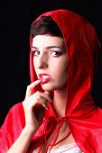 image of little red riding hood  - Attractive woman poses as a Little Red Riding Hood - JPG