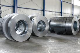 stock photo of tin man  - sheet tin metal rolls in production hall - JPG