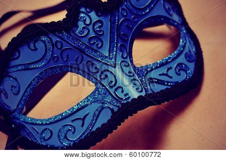 picture of an elegant blue and black carnival mask with a retro effect
