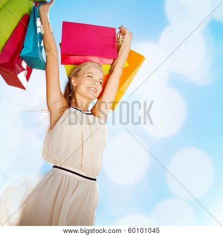 shopping and tourism concept - woman with shopping bags