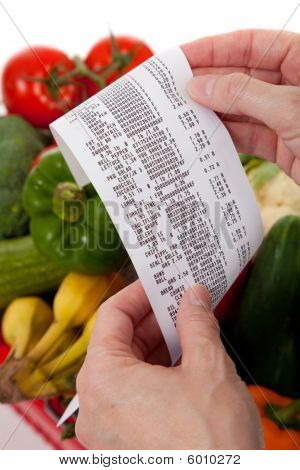 Grocery Receipt Over A Bag Of Vegetables