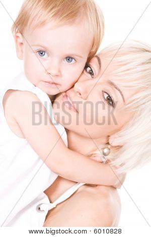 Cute Daughter Hugs Her Mother