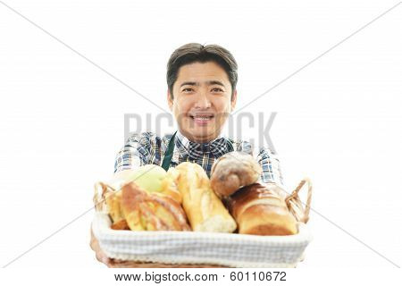 Smiling Asian waiter with breads