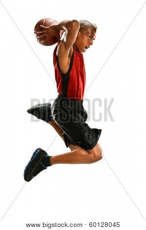 African American basketball player dunking ball isolated over white background
