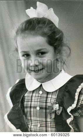 VILNIUS, LITHUANIA, USSR - CIRCA 1967: An antique photo shows portrait of a beautiful schoolgirl.
