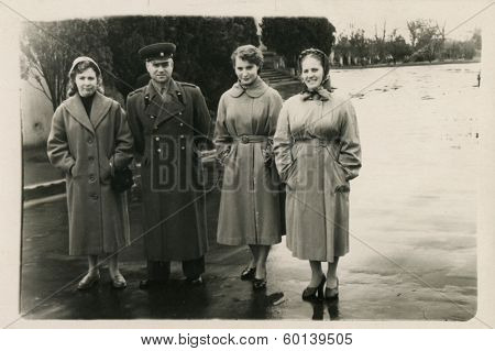 MOCCOW, USSR - CIRCA 1960s: An antique photo shows portrait of a Soviet officer,  his wife and sisters