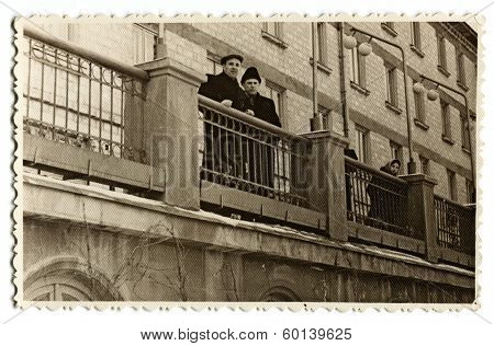 MOSCOW, USSR - CIRCA 1950s:  An antique photo shows portrait of two men standing on the balcony of a historic building