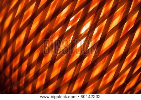Abstract Red Background With Macro Of Wicker Lampshade