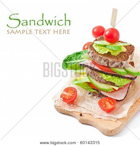 Sandwich with ham and fresh vegetables on white background