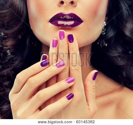 Model with purple makeup and curled hair