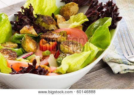 Bowl Of Mixed Green Salad With Brussels Sprouts