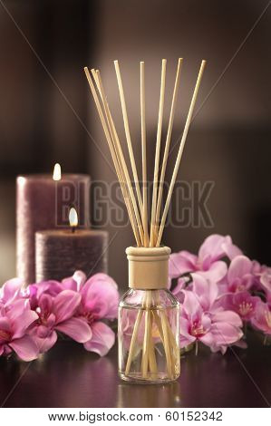 Air Freshener Sticks At Home With Flowers And Ou Of Focus Background