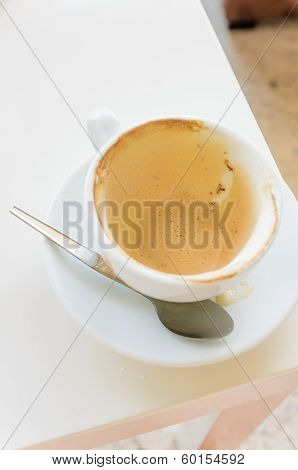 Empty cup of hot coffee in morning time on white table