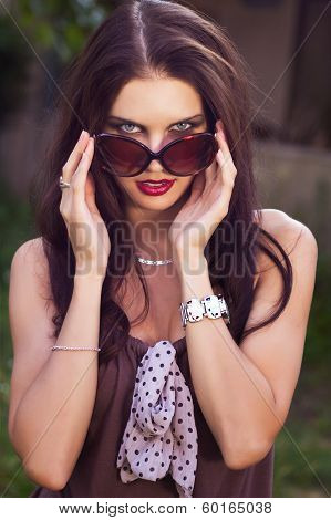Woman Take Off Glasses