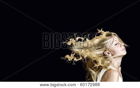 Young attractive blond woman with hair in splashes